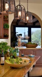 tuscan style the light fixtures and the wood counter