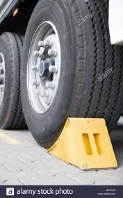 Wheel Chock Stock Photos & Wheel Chock Stock Images - Alamy Dock Chock Truck Wheel Video Dailymotion Aerhock 20 National Plastics Rubber Motorcycle Stand Harley Davidson Tire Road Mount Floor Yellow Wedge Under Tyre Stock Photo 378748 Vestil Mounted Holder For Rwc8tmchrwc8 The Checkers Urethane Discount Ramps Condor Pitstoptrailer Stop Ps1500 Dirt Bike Yellow Wheel Chock Wedge Under Truck Tyre 48378746 Alamy Amazoncom Camco Rv With Padlock Stabilizes Your Basic Use And Safety Tips Jual Harga Murah Bogor Oleh Pt Kakada Pratama 2 Wheel Chocks Leveling Block Blocks Car Rv Camper
