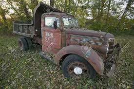Old Truck In Autumn Has