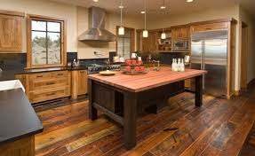 This Rustic Kitchen Has A Very Country Atmosphere The Worn Look In Wooden Floor