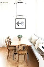 Built In Dining Bench Gorgeous Monochrome Space With Timber Table And Bentwood Chairs