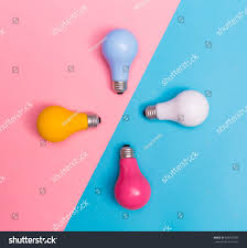 colored light bulbs on blue pink stock photo 634737683