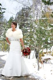 Winter Wedding Gown With Fur Stole And Bouquet