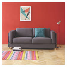 Interior Compact 3 Seater Sofa With Red Wall Design And Small Glass