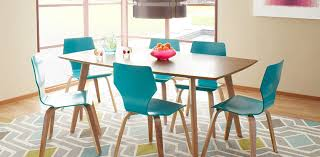 A Light Wood Mid Century Modern Dining Table With Blue Wooden