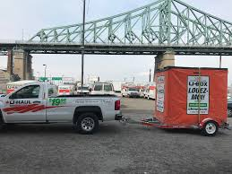 Moving Help® In Montreal, QC Truck Enclosed Utility Trailer Moving Equipment Rental In Iowa Move To This City And Theyll Pay You 100 Uhaul Usa Stock Photos Images Alamy Purchasing A Used Moving For Small Businses Insider Uhaul Rentals Double Springs Elkins Mini Storage 10 U Haul Video Review Box Van Cargo What You How To Drive A Hugeass Across Eight States Without I Spent Three Days Of My Christmas Vacation With 14foot Companies Comparison 20 Foot Best Image Kusaboshicom Ubox Lies The Truth About Cars