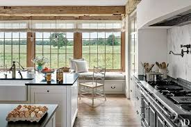 Large Kitchen Windows Provide A View Of Surrounding Farmland At Familys Barn Style House