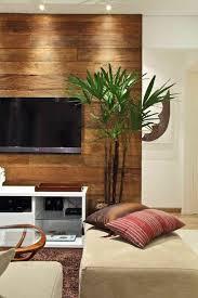 wohnzimmer mit einem fernseher dekorative deko pflanze