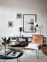 Inspiring Living Room Wall Mirrors Ideas Clocks Painting Black Frame Decor Silver Steel Brown Armchair Table
