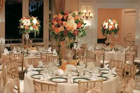 Wedding Favor Packaging Ballroom With Round Tables And Tall Centerpieces