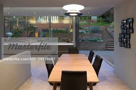 Dining Room At Twilight Overlooking Garden With Open Bi Fold Glass Doors An Plan Home