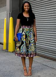 Full Skirt With Bold Pattern Combined Black T Shirt And High Heels
