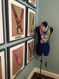 DIY Medal Display Paint A Long Simple Baseboard And Nail As Many Nails Needed Some Loonie Store Letters Glue Them On Take Your
