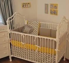grey chevron and yellow crib bedding yellow in the nursery