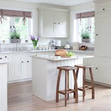 small white kitchen with island kitchen and decor