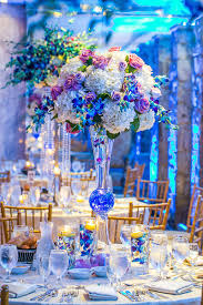 Each Table Had A Tall Floral Centerpiece Complete With Blue Purple And White Blooms