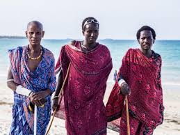 Modern Masai Men In Traditional Clothing