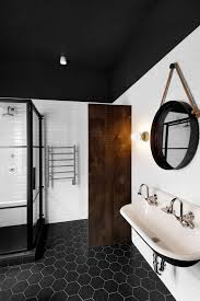 black hexagon floor tiles black ceiling mirror modern