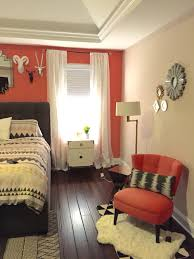 Coral Colored Decorative Accents by Eclectic Master Bedroom With Coral Accent Wall And Faux Taxidermy