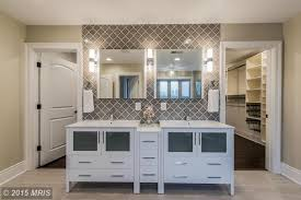 contemporary master bathroom with flush light glass panel in