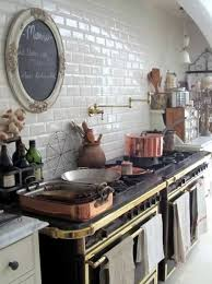 Kitchen With Vintage Gas Stoves And White Subway Tiles Also Copper