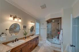 traditional master bathroom with european cabinets handheld