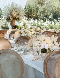 Brown Chairs Around Rustic Elegant Wedding Reception With White And Cream Flower Centerpieces
