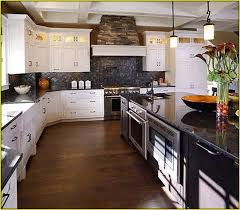 Kitchen With White Cabinets And Black Granite