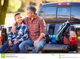 Father And Son Sitting In Pick Up Truck On Camping Holiday Stock ...