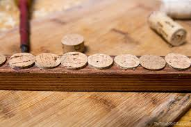 Using Recycled Materials Like Scraps Of Wood And Wine Corks You Can Make A Handy