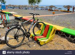 A Colorful Bike Rack Made Out Of Wooden Pallet On Perissa Beach Santorini Greece