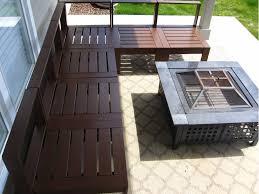Furniture Dark Brown Varnished Pallet Chair With Square Black Metal On Stone Floor