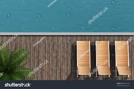 Top View Of A Boardwalk With Three Beach Chair And Palm Tree