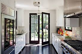 This Madeline Stuart Designed Kitchen In Los Angeles Is Equipped With Pendant Lights From BK