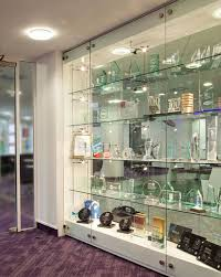 Glass Trophy Display Wall Incorporating Stainless Steel Support Rods To Suspend The Shelves And Provide Power Low Voltage Lighting Custom Built