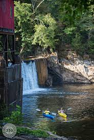Friends kayaking at the base of Whittle s Mill on the Meherrin