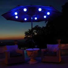 Tilt Patio Umbrella With Lights by Patio Circular Black Iron Umbrella Base Under Blue Colored Patio