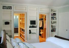 small master bedroom with walk in closet and bathroom