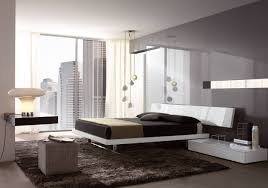Urban Minimalist Bedroom Idea With City View Through Glass Windows And Glossy Walls