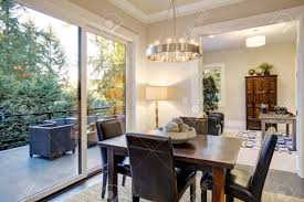 Open Dining Space Design With Soft Beige Walls And Rustic Table..