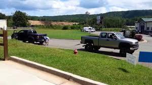Tug Of War Ford Raptor Vs. Chevy Duramax | Muscle Horsepower