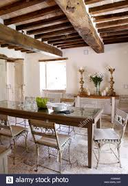 Old Painted Chairs At Rustic Wooden Table In Dining Room Italian Country Villa