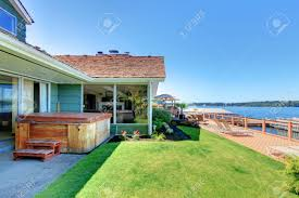 Large One Story Homes by One Story Green House With Tub And Large Tub With Deck And Lake