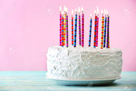 Birthday cake with candles on color background Stock