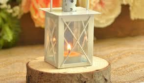 A Lantern Resting On Rustic Wood Coaster