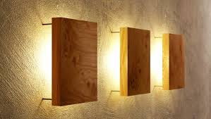wooden wall lights fit perfectly to the interiors of your homes