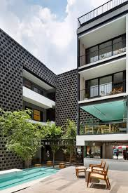 100 Hotel Carlotta JSa Lines Carlota Courtyard With Black Concrete Blocks