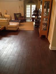 6x24 walnut porcelain plank tile installation throughout home in