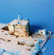Slice of birthday cake with candle Stock