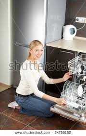 The Blonde Sits Near To Open Dishwasher On Kitchen